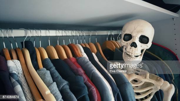 skeleton in the closet - human skeleton stock photos and pictures