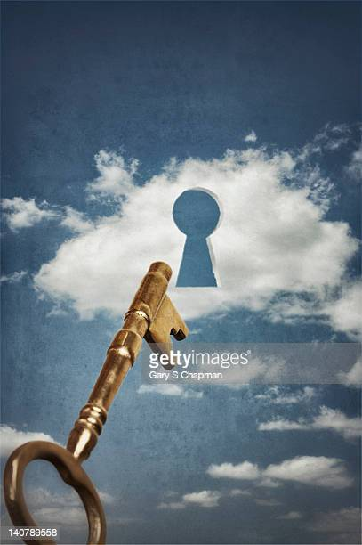 Skeleton key going into cloud with keyhole