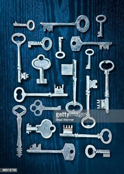 Skeleton Keys Arranged on Dark Wood