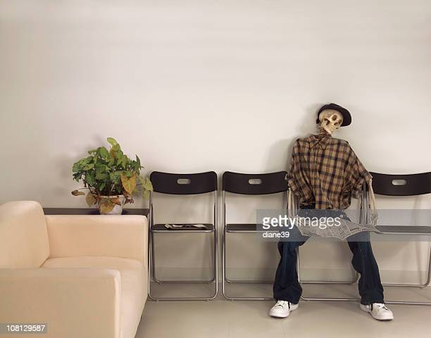 Skeleton Man Sitting Waiting Room with Newspaper