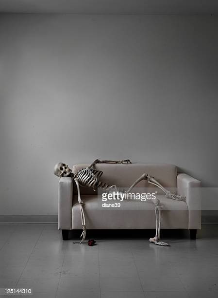 skeleton on a couch