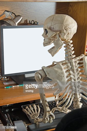 Skeleton On Computer Stock Photo Getty Images