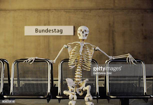 A skeleton sits on a waiting bench during the dress rehearsal of The Magic Flute shown at the new UBahn subway station Bundestag not yet in use on...