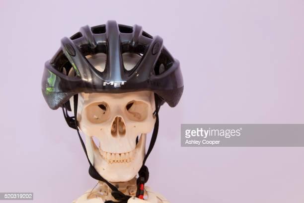 Skeleton wearing a bicycling helmet