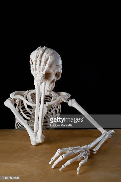 a skeleton with problems - human skeleton stock pictures, royalty-free photos & images