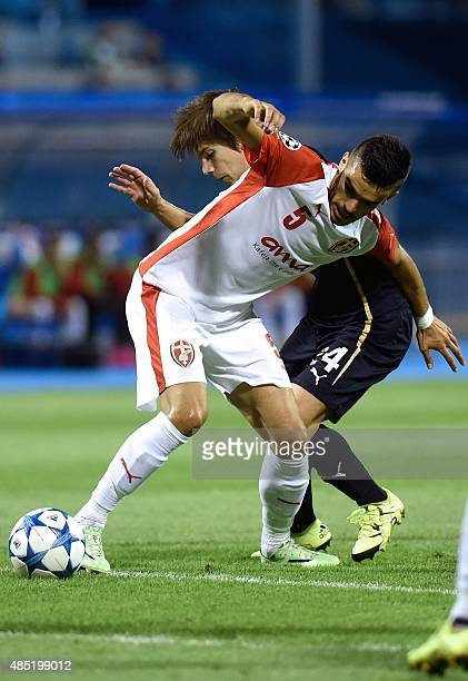 Skenderbeu's defender Bajram Jashanica vies with Dinamo's midfielder Ante Coric during the UEFA Champions League playoff football match between GNK...