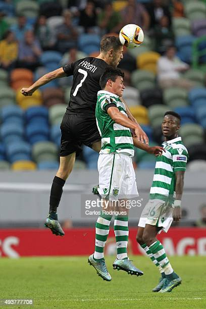 Skenderbeu's forward Gerhard Progni vies with Sporting's defender Jonathan Silva during the match between Sporting CP and KF Skenderbeu for UEFA...