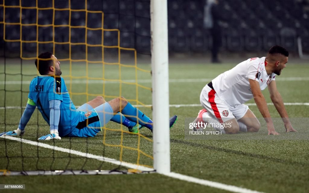 Skenderbeu's goalkeeper Orges Shehi (L) and midfielder Enis Gavazaj react after losing the UEFA Europa League Group B football match between Young Boys and Skenderbeu at the Suisse Stadium on December 7, 2017 in Bern. / AFP PHOTO / Ruben SPRICH