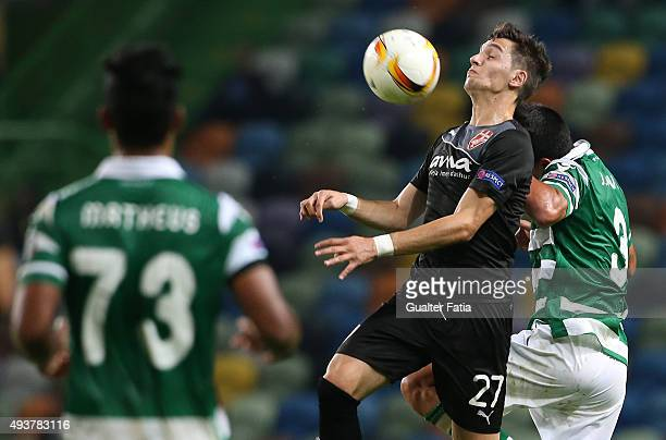 Skenderbeu's midfielder Liridon Latifi with Sporting CP's defender Jonathan Silva in action during the UEFA Europa League match between Sporting CP...