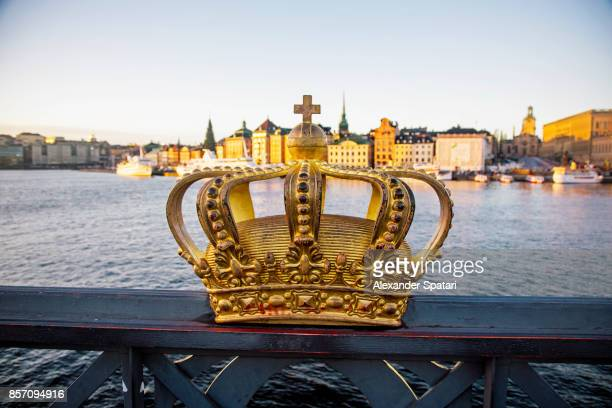 skeppsholmsbron bridge with golden crown in the foreground, stockholm, sweden - the stockholm palace stock pictures, royalty-free photos & images