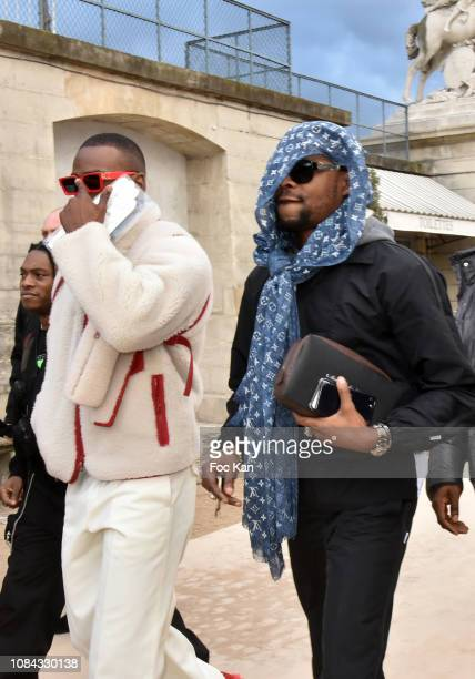 Skepta and a guest attend the Louis Vuitton Menswear Fall/Winter 20192020 show as part of Paris Fashion Week on January 17 2019 in Paris France