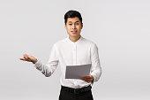 skeptical displeased asian male entrepreneur complaining