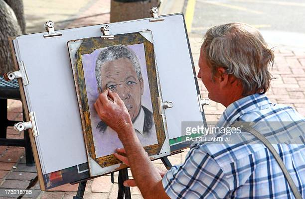 A sketch artist draws a portrait of former South African President Nelson Mandela on July 10 2013 at the North Beach in Durban Mandela is conscious...