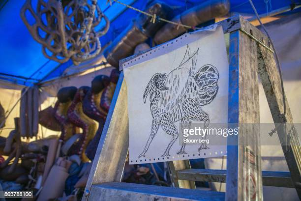 A sketch of an alebrijee Mexican folk art sculpture by artist Ricardo Linares hangs on display at his studio in Mexico City Mexico on Wednesday Oct...