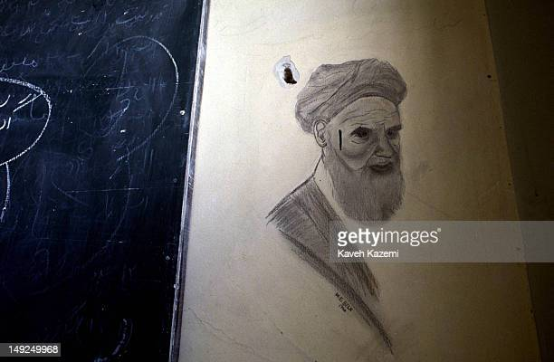 Sketch of Ayatollah Khomeini dated 1980 that was drawn and signed by an American hostage by the name of 'W .E. Belk' appears on the wall next to a...