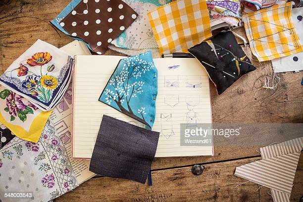 Sketchbook and cloth samples on work desk