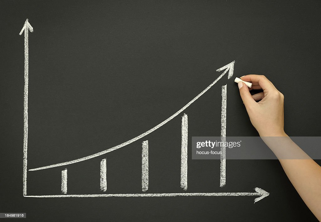 Sketching growth chart on blackboard : Stock Photo
