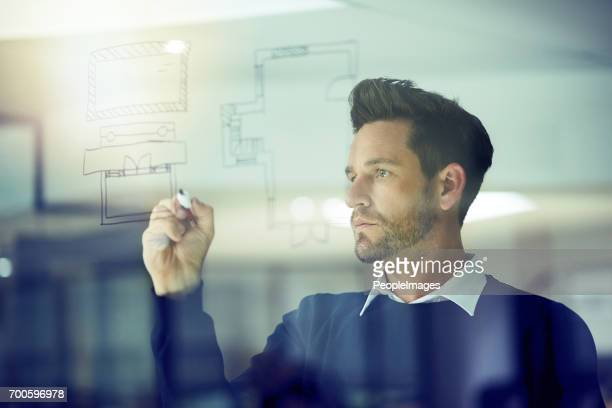 sketching out his bright ideas - man made structure stock pictures, royalty-free photos & images