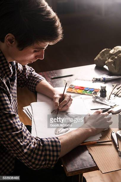 sketching - linkshandig stockfoto's en -beelden