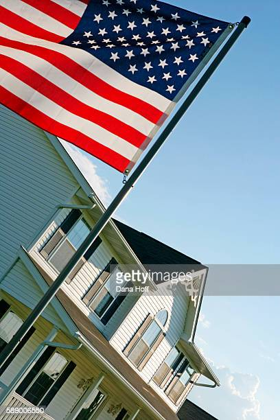 skewed view of american flag in front of white house - dana white stock pictures, royalty-free photos & images