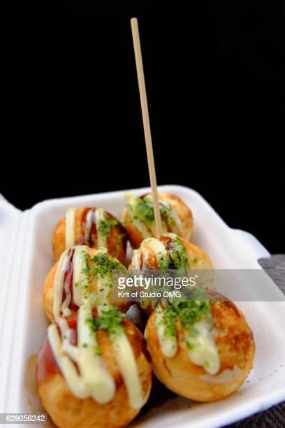 skewer on takoyaki in foam box - takoyaki stock pictures, royalty-free photos & images