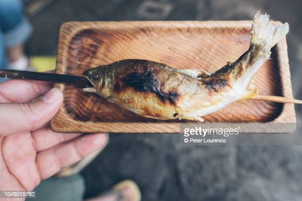 Skewered grilled fish