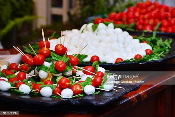 Skewers By Mozzarella And Tomatoes On Table