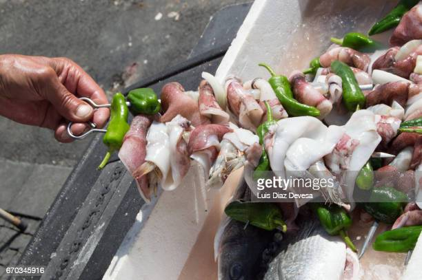 skewers of squid with peppers and onions