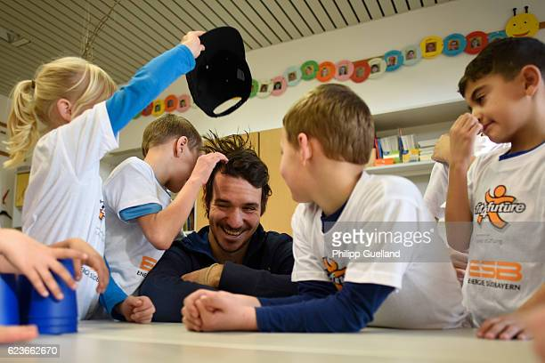 Ski athlete Felix Neureuther has his cap nicked away as he plays with schoolchildren during the kick off for a health initiative for children on...