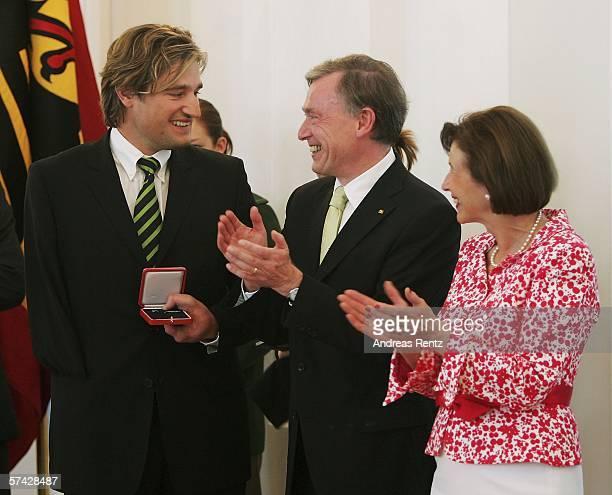 Ski athlete Gerd Schoenfelder an award receives from German President Horst Koehler and his wife Eva Koehler during the ceremony of the 'Silbernes...