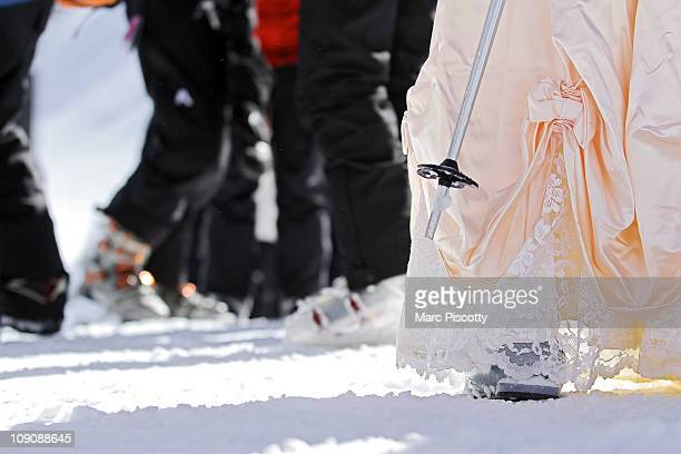 Ski boots and poles mixed with wedding dresses atop Loveland Ski Area at the 20th Annual Marry Me Ski Free Mountaintop Matrimony on Valentine's Day...