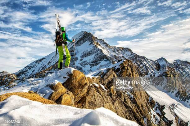 ski climber with a view of the summit - tall high stock pictures, royalty-free photos & images