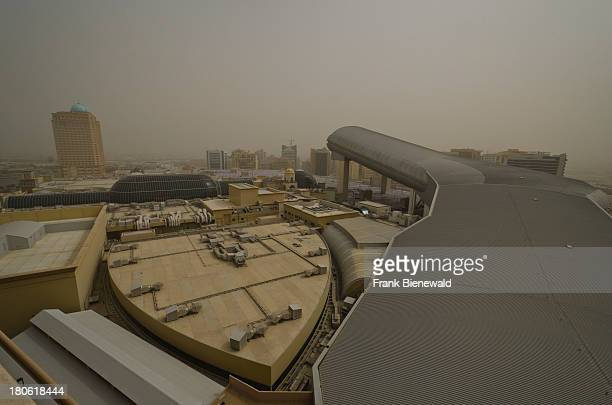 Ski Dubai the worlds largest indoor ski area seen from outside during a sandstorm