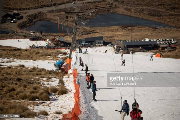 Ski enthusiasts reach the top of the main 1km slope at the Lesotho Kingdom ski resort Afriski in the Maluti Mountains on July 11 2018 Nestled high in...