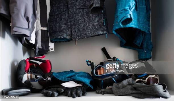 Ski equipment cluttered in a closet