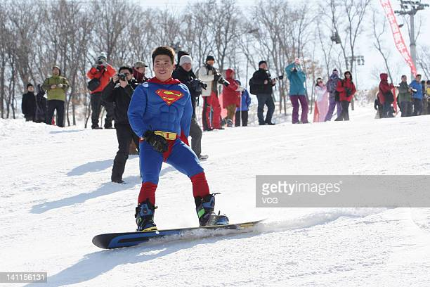 A ski fan dressed as Superman skis during an Underwear Ski Festival at Lotus Mountain Ski Resort on March 11 2012 in Changchun China