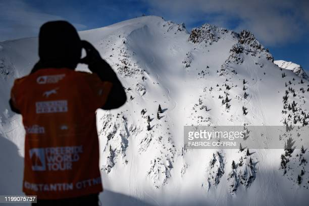 Ski freeride racer Konstantin Ottner of Germany stands in front of the competition site the Ozone face during the face check ahead of the second...