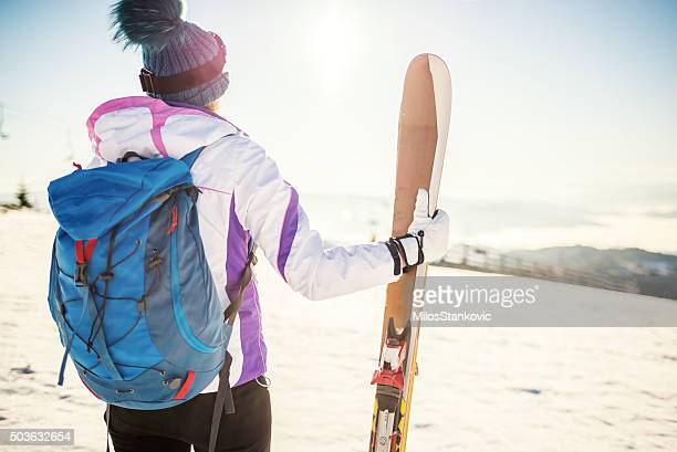 Ski girl on mountain