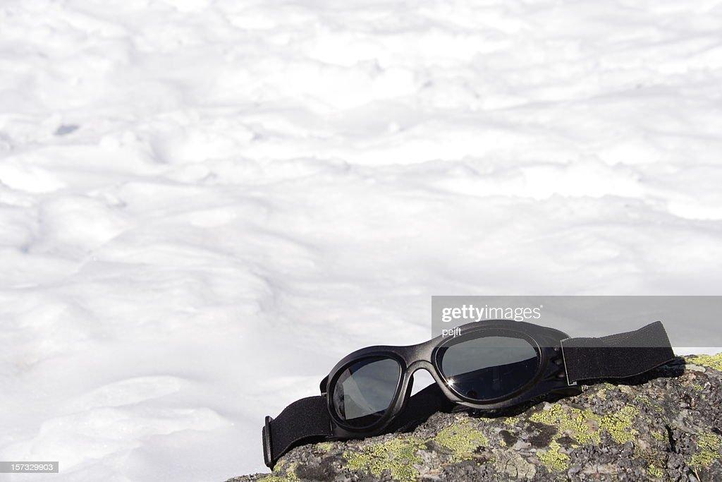 Ski goggles on a rock : Stock Photo