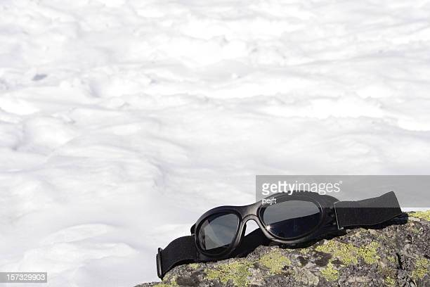 Ski goggles on a rock
