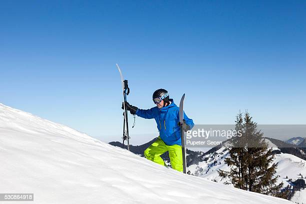 Ski holiday, Skier hiking uphill, Sudelfeld, Bavaria, Germany