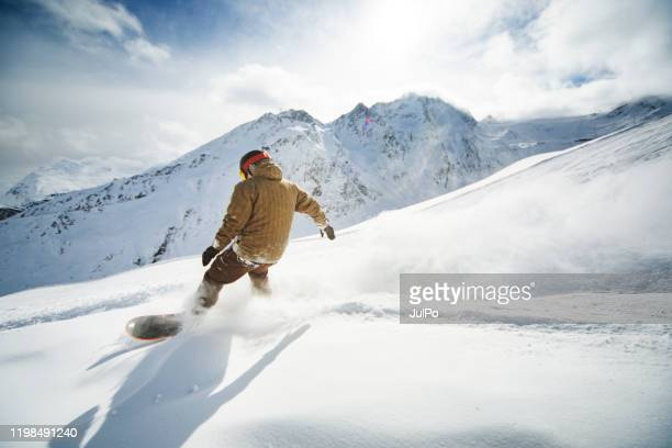 ski holidays - snowboarding stock pictures, royalty-free photos & images