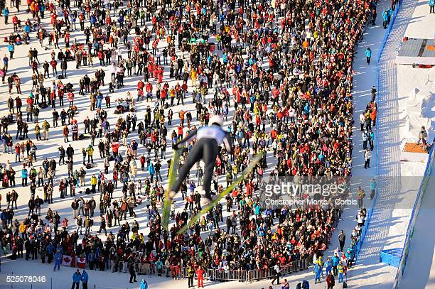 A ski jumper above the crowd during the qualification round for the long hill individual ski jumping at Whistler Olympic Park on day 8 of the...