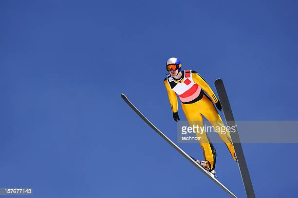 ski jumper against the blue sky - ski jumping stock pictures, royalty-free photos & images