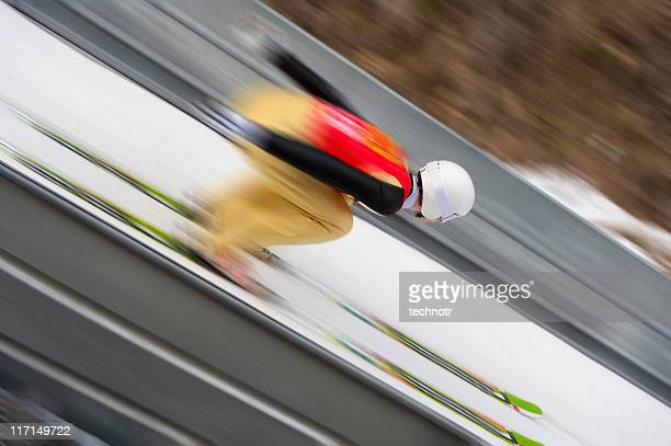 ski jumper at the inrun section - ski jumping stock pictures, royalty-free photos & images