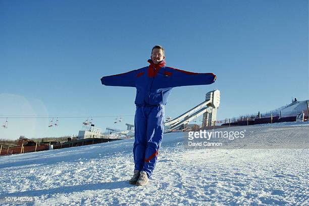 Ski jumper Eddie The Eagle Edwards of Great Britain poses for a portrait in front of the 90 and 70 metre ski jumps on 24th February 1988 during the...