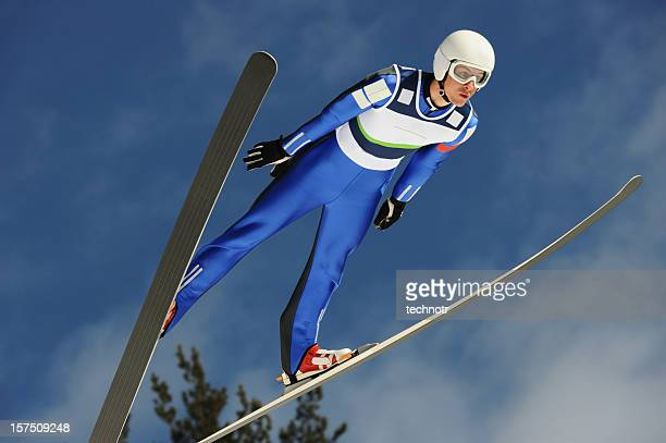 ski jumper flying - ski jumping stock pictures, royalty-free photos & images