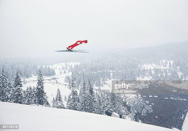 ski jumper flying through air. - madison grace stock pictures, royalty-free photos & images