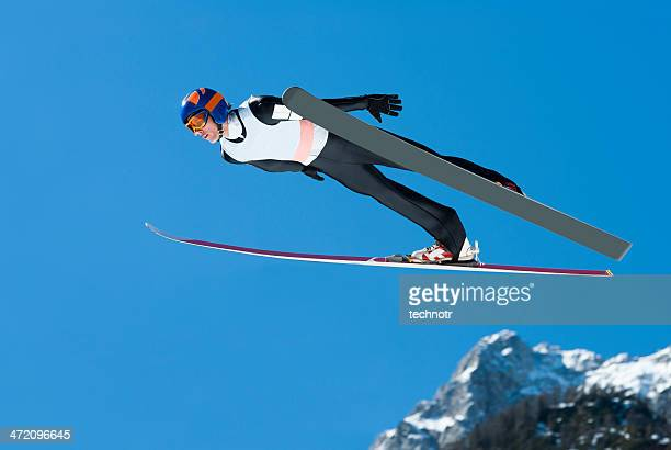 ski jumper in action against the blue sky - ski jumping stock pictures, royalty-free photos & images