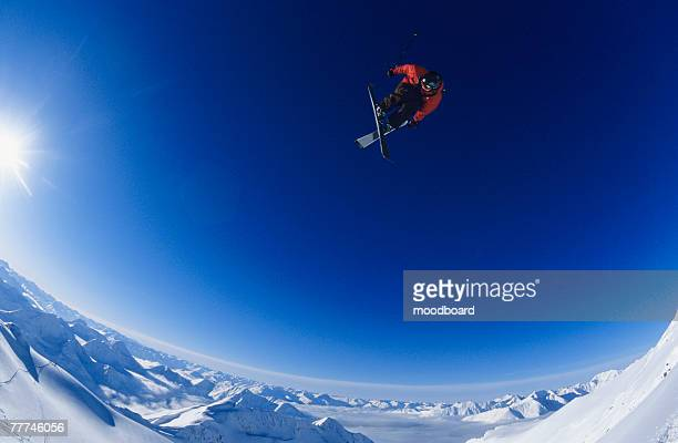 ski jumper in clear blue sky - ski jumping stock pictures, royalty-free photos & images